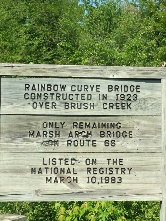 Rainbow Curve Bridge Sign
